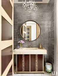 a 1960s hans harald rath chandelier presides over the refined powder room of a manhattan