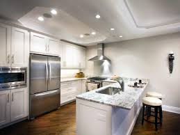 contemporary white kitchen with stainless steel appliances