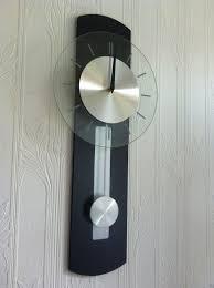 quartz pendulum wall clock with silver