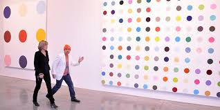 damien hirst right at the new york press preview for damien hirst the complete spot paintings 1986 2016 photo andy guzzonatto