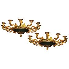 matched pair of french empire style two tone bronze twelve light chandeliers for