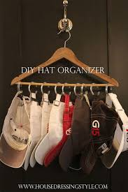 diy hat hanger with curtains rings and a hanger