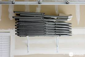 Wall storage for folding chairs