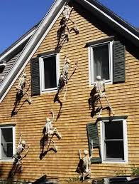 Skeletons Climbing On A House...so Cool! These Are The BEST Halloween