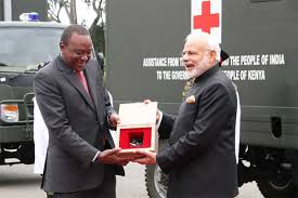 the prime minister narendra modi handing over the field ambulances to the president of kenya