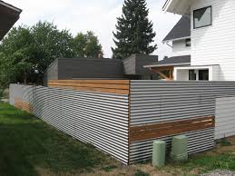 sheet metal privacy fence. Corrugated Metal Fence Designs. Good Use Of Inexpensive Materials Mixed In With Traditional Wood Sheet Privacy E