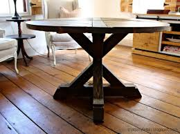 a diy tutorial to build an x base dining table with a circular top a modification on an ana white plan by changing the top to a circle