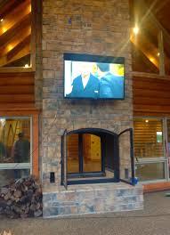 custom see through wood burning indoor outdoor fireplace outdoor view