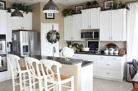 white painted cabinetsGreenery above kitchen cabinets ideas in white painted cabinets