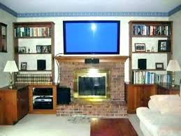 television over fireplace design mounting above fireplace studs hang hanging over without kit ideas televisions over
