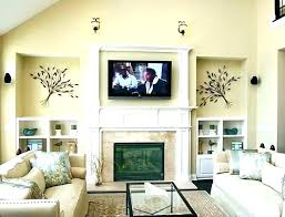 tv mounted above tv stand over fireplace mount television wall mounted hide wires above hiding