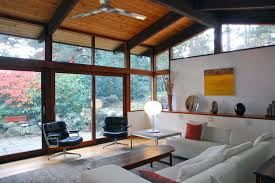 the wall paint color is white dove oc 17 benjamin moore the wood flooring is a clear ash the ceiling beams are are blu lam beams with a dark stain