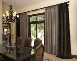 modern living room design with black curved curtain rod and wooden glass door also grey chairs plus wooden glass table