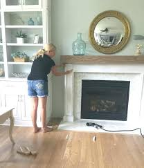 building a fireplace surround wood beam mantel faux stone diy