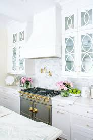 kitchen ideas cabinets glass doors pink marble kitchen countertops tall white cabinets faucets and fixtures painting a table