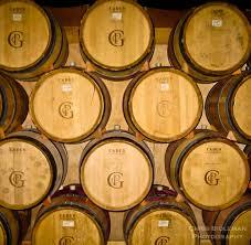 oak wine barrels. oak wine barrels stacked in a winery aging the red willamette valley