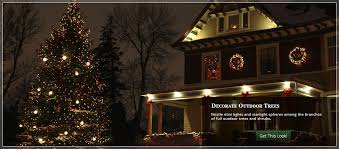 christmas tree lighting ideas. Starlight Spheres And Christmas Lights Tucked Into The Boughs Of A Large Outdoor Tree. Tree Lighting Ideas