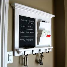 white wooden wall mounted mail organizer with black color