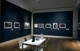 track lighting for artwork. virginia museum of contemporary art uses ge retail led lighting in a room with table and track for artwork