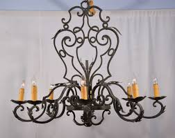 eight light oval wrought iron chandelier featuring beautiful scroll work in the single dimension support