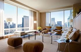 Rather than compete with the view, the room showcases the city beyond the  stunning floor