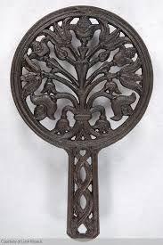 antique trivets made in the 19th and early 20th century are commonly made of cast iron or brass straight out of the industrial revolution