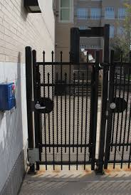 exterior gate lock. active gate has a lever handle lockset and also an electromagnetic lock . exterior