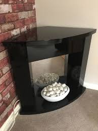 next corner fireplace electric vvvgc black with white pebbles works perfectly 2 heat settings