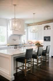 stunning white kitchen with silver lanterns and dark leather barstools lantern lighting kitchenchandelier kitchen islandkitchen
