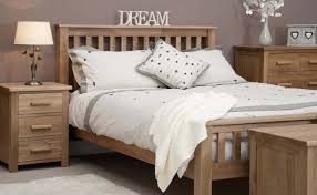 bedroom oak furniture. Exellent Bedroom Bedroom With Grey Walls And Solid Oak Furniture Also White Bedding In A