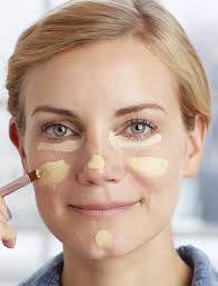 to neutralize redness on your cheeks nose and chin swipe on a yellow based cream concealer
