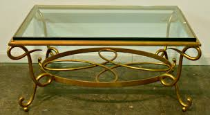beautiful round metal coffee table with glass top with coffee