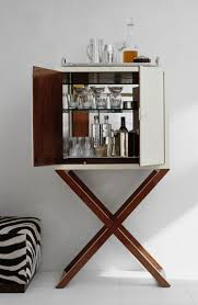 home cocktail bar furniture. a chic bar cabinet reveals the makings of cocktail hour by ralph lauren home furniture