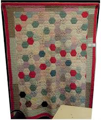 Quilt Inspiration: Vintage Hexagon Quilts & Large hexagons of alternating solids and stripes give an almost