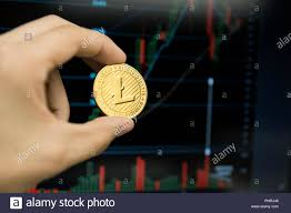 Litecoin Growth Chart Male Businessman Hand Holding Litecoin Coin On A Background