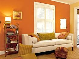 small living room with orange wall paint colors for painting