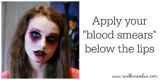 apply your blood smears below your lips zombie makeup tutorial face painting