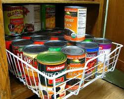 canned goods in pull out shelf in cabinet