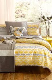 a fun yellow quilt cover with a touch of beige and white