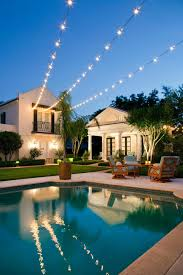 outdoor pool lighting. Traditional Pool With Poolhouse And Twinkly Outdoor Lighting