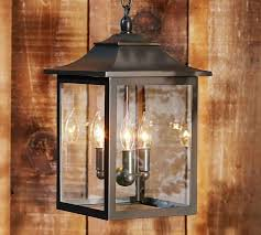 inspiring outdoor lantern light fixture box and top wooden combination of black color wooden wall