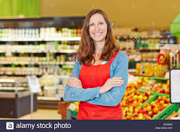 Portrait Of Smiling Female Store Manager In A Supermarket With Her