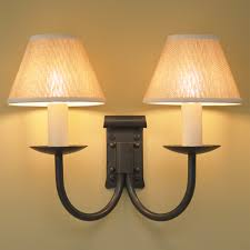 emley double wrought iron wall light in natural black with ivory candle s shades
