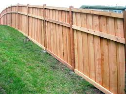 installing a fence how to build wood on uneven ground best