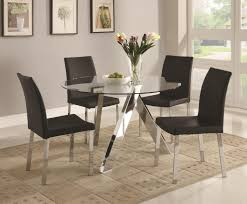 round glass dining table on chrome base connected by black chairs from modern dining room glass table with rug flooring source pauletteshomes com