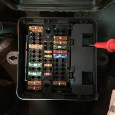 how to access the compartment under the engine bay fuse box vw plastic part where the red meter lead is the whole inside of the box comes out leaving a hole where you can see into the compartment i m referring to