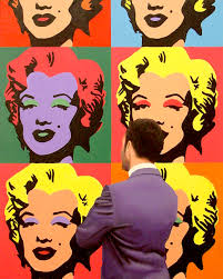 painting of man enjoying painting of marilyn monroe by andy warhol