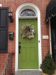 brick black shutters and green doorstill like this
