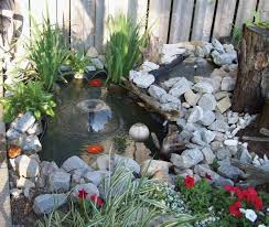 koi pond lighting ideas. a small twosection pond with waterfall between the two both sections have koi lighting ideas c