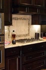 over the stove backsplash | The mother of pearl backsplash above the stove  with white ceramic ... | Kitchen Ideas | Pinterest | Stove backsplash, ...